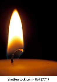 Candle flame closeup over black - Christmas or general use