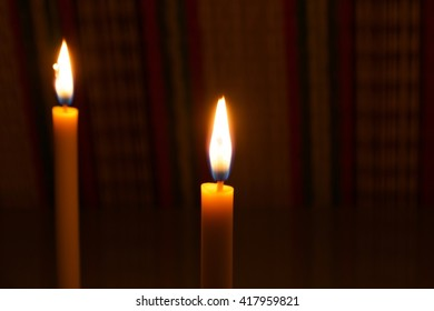 Candle flame light at night