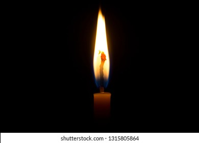 Candle flame on black background