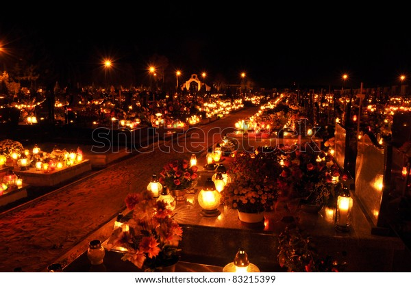 Candle flames illuminating a Polish cemetery during All Saint's Day