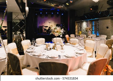 Candle and flower decoration for an event party or wedding on the table in restaurant