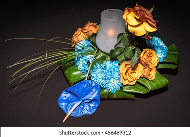 Candle and flowers on the table