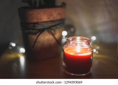 a Candle in a Glass at Christmas