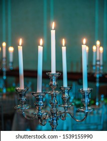 Candle holder with candles in a room