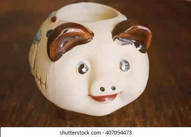 Candle holder piggy figurine