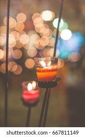 candle light and blurred light background / dark film tone
