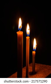 Candle and light in dark black