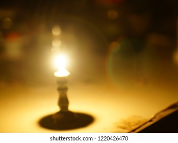 candle light with natural lens flare in completely dark place. Blur