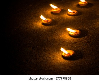candle light on concrete floor