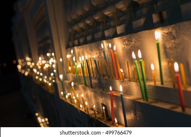 candle light on wall the temple reminisce King.
