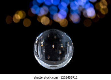 Candle lighted and Magic crystal ball of divination. Interpretation of dreams, Psychic, fortune telling