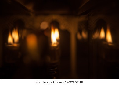 Candle lights blurred background for flyer or advertisement