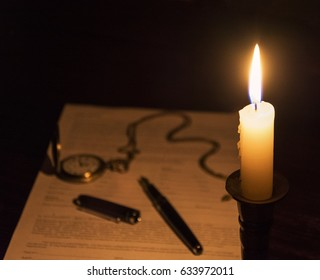 Candle lights in the dark business table.
