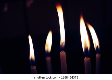 Candle lights in the darkness. Abstract candles background. Hope, fire.