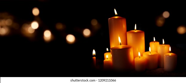 Candle lights and festive golden bokeh in the christmas night