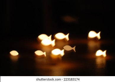 candle lights filtered fish background.