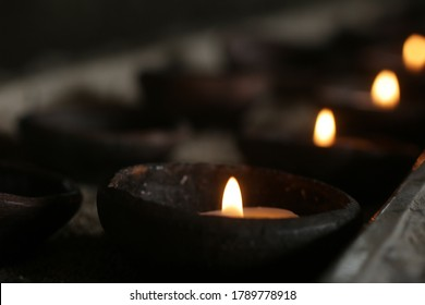 Candle lights on a traditional ceramic bowls on dark background. Holy week concept. Spiritual concepts. - Shutterstock ID 1789778918