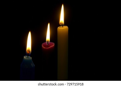 Candle lights shining bright in the dark