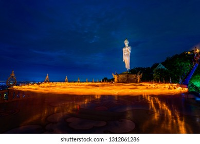The candle lit ceremony around the Buddha image, Makha Bucha Day, Candle lit from buddhists are moving around Buddha statue, people walk with lighted candles in hand around a temple to the Buddha