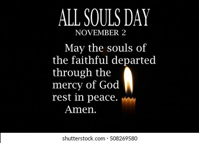 Candle lit in the dark isolated background with prayer text for All souls day