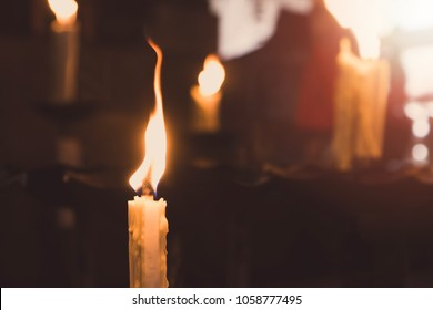 The candle was lit on the altar.Vintage tone.