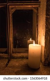 Candle lit room in a mountain hut at night, in Friuli Venezia Giulia, Italy.