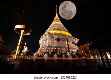 Candle lit tradition, walk with lighted candles in hand around a temple with beautiful moon