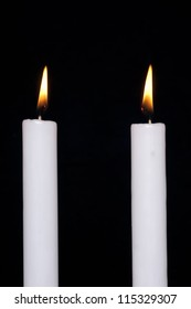 A candle on black background