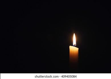 candle on black background isolated