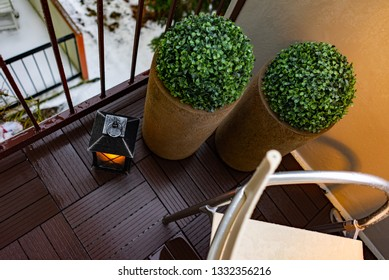 A candle on the botton on a balcony. Beautiful modern interior design.
