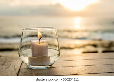 Candle on a table at sunset view cafe, Sunset Point, Nusa Lembongan, Indonesia. Concept of calmness, romance, serenity.