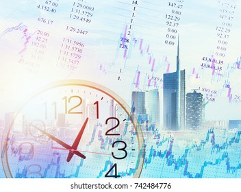 Candle stick graph chart of stock market and wall clock