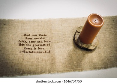 Candle and table runner scene of 1 Corinthians 13:13 Bible verse at wedding