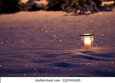 Candle in the winter garden
