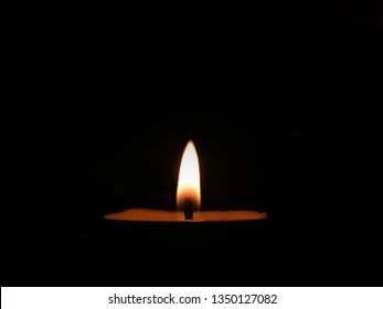 Candlelight in black background.candle flame in dark room. Calm concept.
