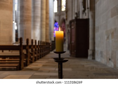 candlelight in church nave altar in historical city south germany city of schwaebisch gmuend