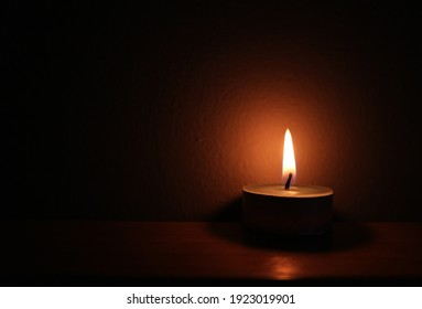 The candlelight in the darkroom, black background
