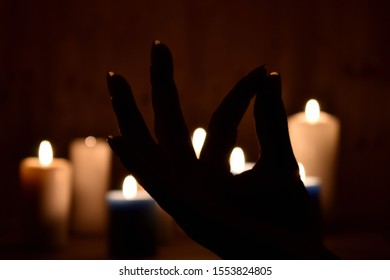 Candlelight meditation at night. Religious Buddhist symbol. Calmness and pacification background.
