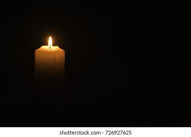 A candlelight on the black background