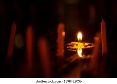 The candlelight that illuminates the orange light is even close.