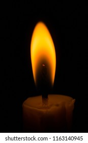 Candlelight,candle flame in dark room.