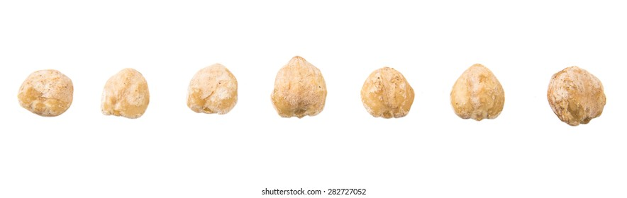 Candlenut seed over white background