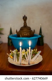 candles and buddha sculpture
