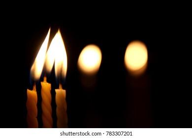 Candles burn at night