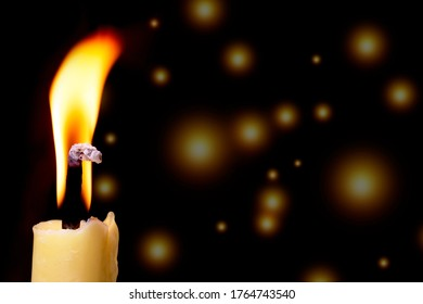 Candles burn at night. focusing on one candle ahead.