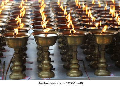 Candles burning in a Buddhist temple in China