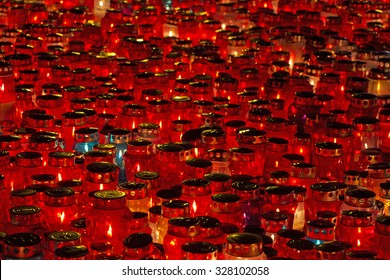A lot of Candles Burning At a Cemetery During All Saints Day