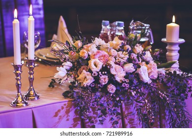 candles burning near flowers and decor