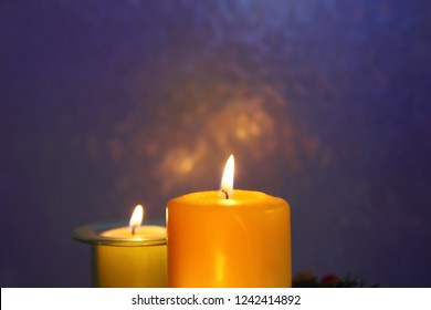 Candles by the night window at Christmas. New year gift. Purple background