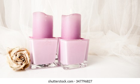 Candles with Christmas decorations on a white background.